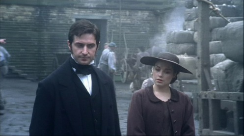 Richard Armitage as Mr. Thornton and Daniel Denby-Ashe in episode 2 of NOrth & South. Those would be bales of ginned cotton in the background. Source: RichardArmitageNet.com