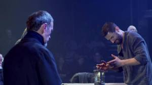 Reverend Hale (Adrian Schiller) witnesses John Proctor's (Richard Armitage) frustration with his inability to remember the last of the Ten Commandments, in Act Three of The Crucible. Screencap.