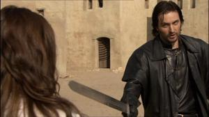 Guy of Gisborne (Richard Armitage) threatens Lady Marian (Lucy Griffiths) shortly before murdering her, in Robin Hood 2.13. Source: RichardArmitageNet.com