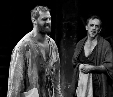 Hale (Adrian Schiller) looks on in pain as Proctor (Richard Armitage) rips his confession in half, in Act Four of The Crucible. Source: Unknown