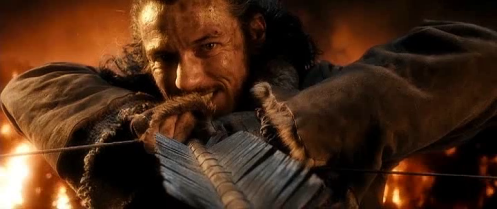 Bard (Luke Evans), his face full of bloodlust, aims at Smaug in The Hobbit: The Battle of the Five Armies. Screencap.
