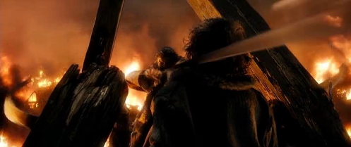 Bard (Luke Evans) lets go the arrow that will kill Smaug, in The Hobbit: The Battle of the Five Armies. Screencap.