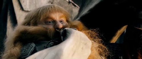 Bombur (Stephen Hunter) blows to announce the dwarves' entry onto the battlefield in The Hobbit: The Battle of the Five Armies. Screencap.