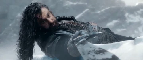 Thorin (Richard Armitage) pulls Orcrist from the body of a falling orc, in The Hobbit: The Battle of the Five Armies. Screencap.