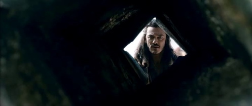 Reverse angle on a shot from the previous post: Bard (Luke Evans) at the parley with Thorin Oakenshield in The Hobbit: The Battle of the Five Armies. Screencap.