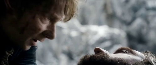 Thorin Oakenshield (Richard Armitage) apologizes for putting Bilbo (Martin Freeman) into so much peril, in The Hobbit: The Battle of the Five Armies. Screencap.