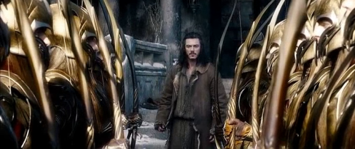 Bard (Luke Evans) encounters the elvish Army in Dale, in the Hobbit: The Battle of the Five Armies. Screencap.