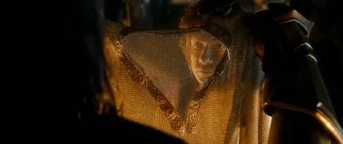 Thorin Oakenshield (Richard Armitage) presents Bilbo (Martin Freeman) with a mithril shield, in The Hobbit: The Battle of the Five Armies. Screencap.