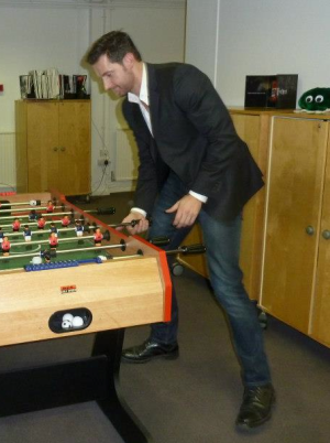 The man in question plays foosball with Jamie Edwards.