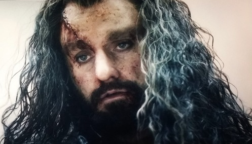 Latest jolt to the solar plexus: Thorin Oakenshield (Richard Armitage) looks down at Azog in The Hobbit: The Battle of the Five Armies. Screencap.