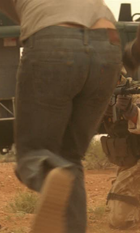 John Porter (Richard Armitage) and Katie Dartmouth (Orla Brady) run for the helicopter in Strike Back 1.2. Screencap.