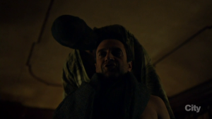 Dolaryhyde / The Dragon (Richard Armitage) examines Chilton (Raul Esparza) with predatory curiosity, in Hannibal 3.12. Screencap.