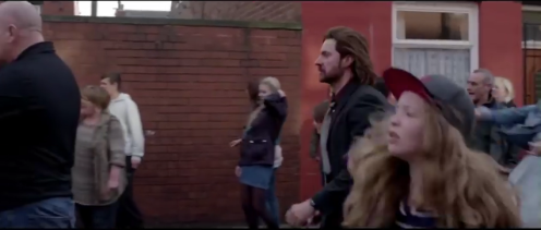 Caps from various trailers distributed from the film. Dunno, but I think Chop's participating in riot. In one place I see the cops kicking him.