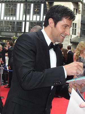 Richard Armitage signs autographs at the BAFTA red carpet, May 2010.