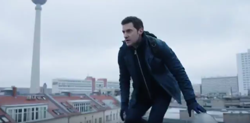 Daniel Miller (Richard Armitage) stands on a rooftop in the teaser trailer from Berlin Station. My cap.