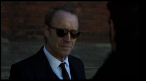Rhys Ifans as Hector de Jean -- dropping a plotline about ISIL on us, in Berlin Station 1.1.