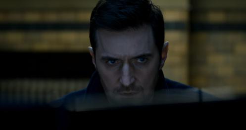 Beautiful shot of Daniel watching the interrogation.