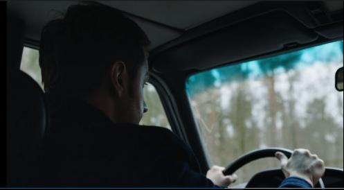 Beautiful shot of Daniel Miller, driving the car.