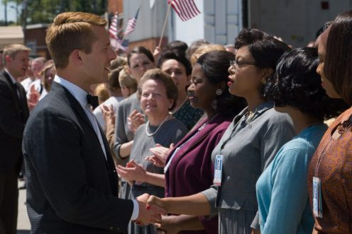 Katherine G. Johnson (Taraji P. Henson), flanked by fellow mathematicians Dorothy Vaughan (Octavia Spencer) and Mary Jackson (Janelle Monáe), meet the man they helped send into orbit, John Glenn (Glen Powell) in HIDDEN FIGURES. Photo by Hopper Stone