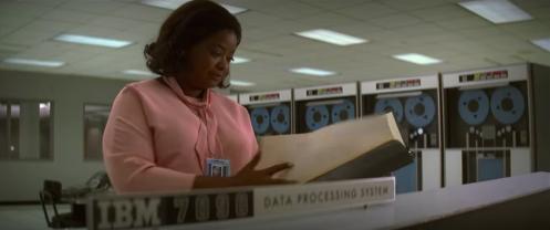 Dorothy Vaughan (Octavia Spencer) peruses the IBM 7090 manual.