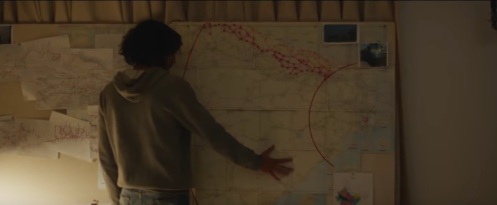 The adult Saroo (Dev Patel) and his attempt at mapping out his childhood journey, from Lion.