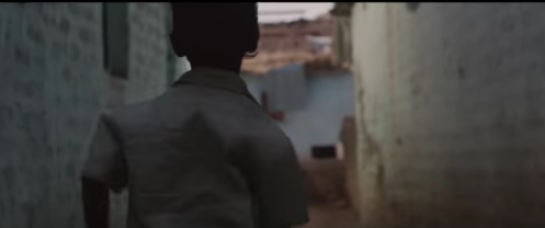 In the adult Saroo's dream, the boy Saroo runs home every night from the train station.