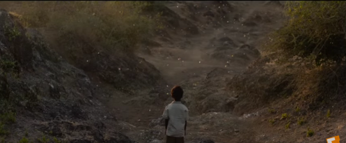 The boy Saroo in the adult Saroo's dreams, in the landscape of home.
