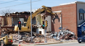 Crews from Guelig's Waste Removal began demolition of the former village library on Saturday, April 23. By Monday morning, the building was completely down and crews worked on removing some remaining debris. John Faucher photo